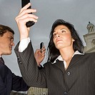 Businesswoman and Businessman Using Cell Phones
