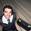 Businessman Wearing Headphones (thumbnail)
