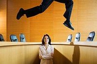 Businesswoman Watching Leaping Businessman