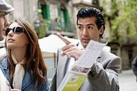 Tourist Couple Receiving Guidance