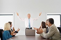 Businesspeople Applauding in a Business Meeting