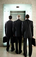 Businessmen Waiting for Elevator