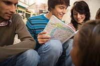 Young Friends Checking a Map