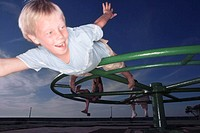 Boy Lying Down on Top of Merry-go-round