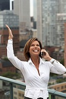 Excited Businesswoman Using Cell Phone