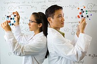 Scientists Holding Molecules