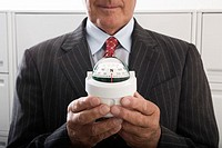 Businessman Holding Compass