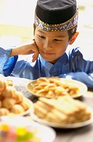 Young Boy Looking at Sweets during Hari Raya Aidilfitri