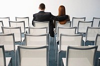 Businesswoman and Businessman in Auditorium