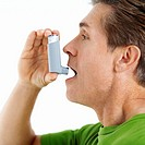 Man Using Inhaler