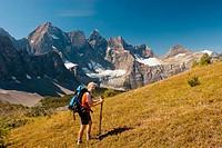 Hiker at Goodsir Pass, Mount Goodsir 3567m (11,703´) in the background, Kootenay National Park. British Columbia. Canada.