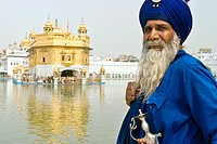A Sikh in front of the Golden Temple in Amritsar. Amritsar is located in the State of Punjab