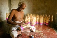 A man painting a Maria in Pitchavaran. This hindu is working in his house painting christian figures being sold in a big christian pilgrimage place in...