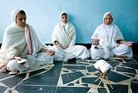 Three of the Jain sadhvis meditating in there room before having their lunch in Brindavan. This was shot after a 20 klm walk from Mysore to Brindavan....