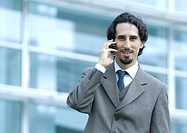 Businessman using cell phone, portrait