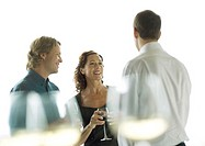 Three people chatting and drinking wine