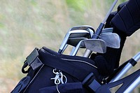 Close-up of golf clubs in a golf bag