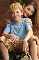 Portrait of a girl and her brother holding a fishing rod