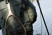 Mid section view of a person with a fishing net on his back