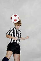 Low angle view of a soccer player heading a soccer ball (thumbnail)