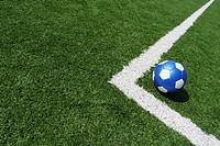 High angle view of a soccer ball near a yard line