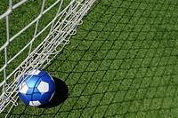 High angle view of a soccer ball near a net