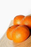Close-up of four oranges
