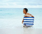 Portrait of a young woman sitting on a lounge chair, Bermuda