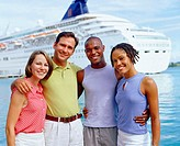 Portrait of two young couples standing in front of a cruise ship and smiling, Bermuda