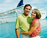 Portrait of a young couple embracing each other in front of a cruise ship, Bermuda