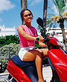 Low angle view of a young girl riding a scooter, Bermuda