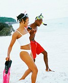 Side profile of a young couple walking on the beach, Bermuda