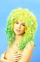 Studio shot of nude woman wearing wig with birds