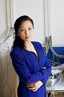 Portrait of a businesswoman standing with her arms crossed in a server room