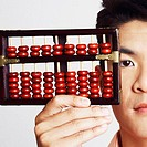 Portrait of a young man holding an abacus