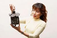 Close-up of a mature woman holding a lantern