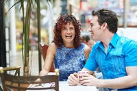 Mature woman and a mid adult man sitting in a cafe