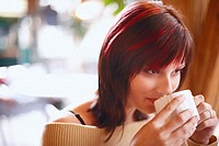 Close-up of a young woman drinking coffee