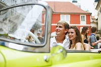 Young couple sitting in a car (thumbnail)