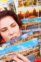 Young woman looking at postcards