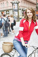 Portrait of a teenage girl sitting on a bicycle