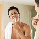 Close-up of a young man applying lip balm (thumbnail)