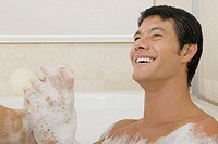Close-up of a young man in a bubble bath