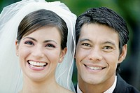 Portrait of a newlywed couple smiling (thumbnail)