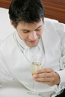 High angle view of a mid adult man holding a champagne flute