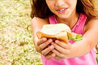 Close-up of a girl holding a hamburger