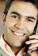 Portrait of a mature man talking on a mobile phone