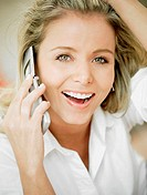 Portrait of a mid adult woman talking on a mobile phone and smiling