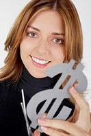 Portrait of a businesswoman holding a dollar sign with a pair of scissors and smiling (thumbnail)