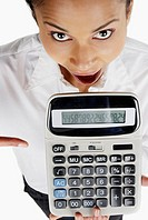 Portrait of a businesswoman holding a calculator with her mouth open (thumbnail)